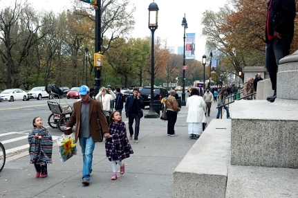 Girls walk with their father in the Upper East Side.