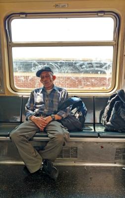 Man sleeps on his commute.